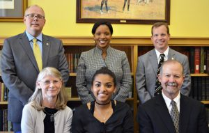 Maya Hill is seated between Jim and Cathy Brazeal and joined by J.D. Bowers, Director of the Honors College, Kia Breaux, alumnae and member of the Alumni Advisory Council, and Charles May, Director of Admissions at MU.