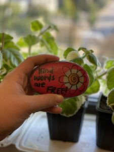 "Rock painted with the words ""Kind words are FREE!"""