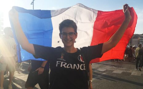 Anna Merkel holding French flag