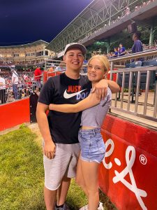Cade McKnelly and friend pose at a sports stadium