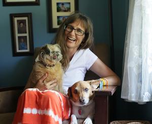 Portrait of Deborah Huelsbergen and her dogs.