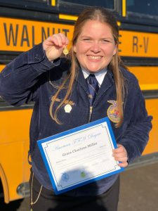 Grace Miller shows off her FFA award