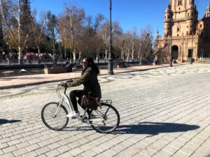 Toyin Jackson riding a bike on streets of Seville