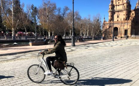Student riding a bike in Seville