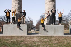 "The Stamps Scholars spelling ""MIZ-ZOU"" on the Columns"