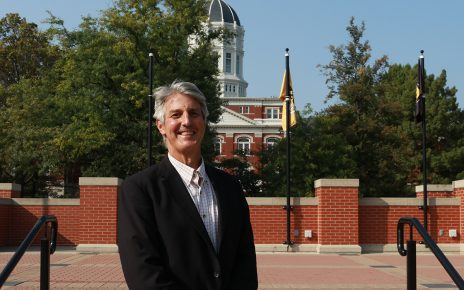 David Schenker stands in front of MU's Jesse Hall in Traditions Plaza