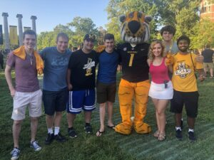 Aravind Kalathil and other students and Truman the Tiger at Tiger Walk event.