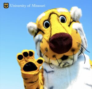 Truman the Tiger waving